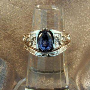 CroppedImage400400 carved flower 2ct sapp ring