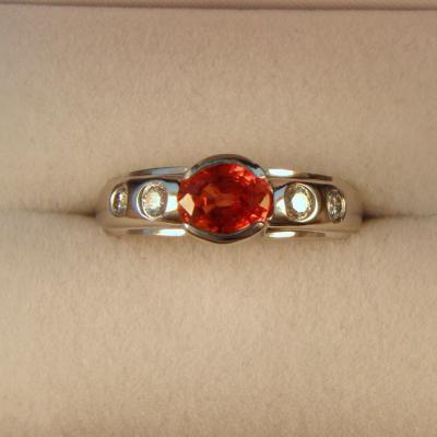CroppedImage400400 nat orange sapp bezel ring