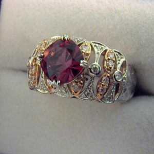 CroppedImage400400 two tone rg garnet ring