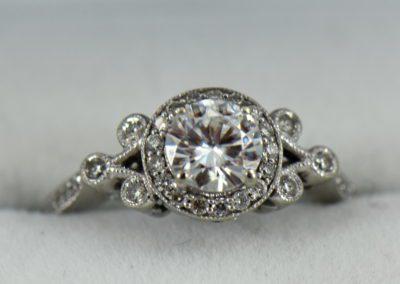 Custom vintage style moissanite halo ring in white gold