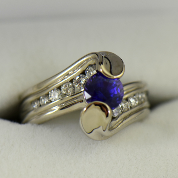 Custom palladium wedding ring with round blue purple color change sapphire