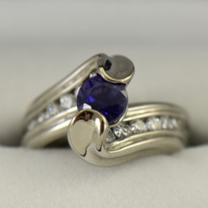 Custom palladium wedding ring with round blue purple color change sapphire 5