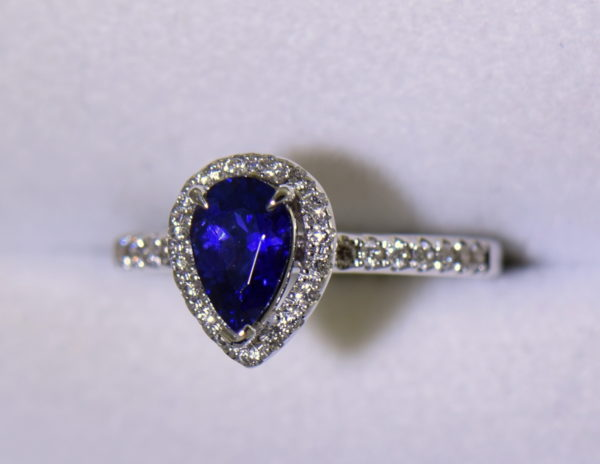 Blue Violet Pear Sapphire Halo Engagement Ring 5 outdoor.JPG
