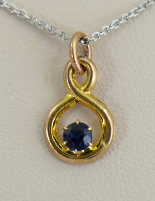 Edwardian Infinity Pendant with Round Blue Sapphire Pin Conversion.JPG