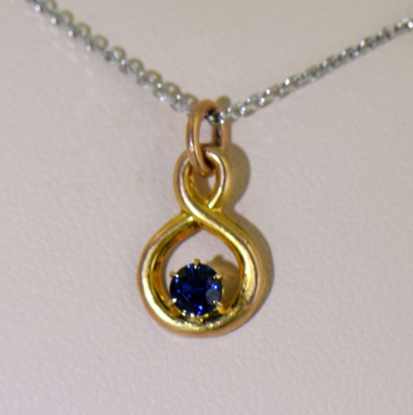 Edwardian Infinity Pendant with Round Blue Sapphire Pin Conversion 2 natural light.JPG