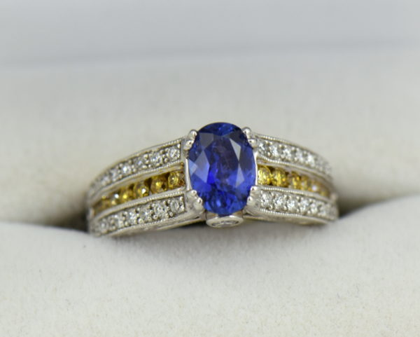 Violet Color Change Sapphire Ring with White Yellow Diamonds.JPG