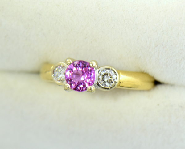 Round pink sapphire bezel diamond three stone ring.JPG