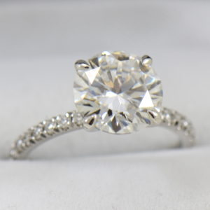 4ct moissanite solitaire engagement ring on thin diamond shank.JPG