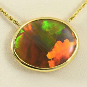 Amazing Reversible Brown base Ethiopian Opal Bezel Necklace in 14k yellow.JPG