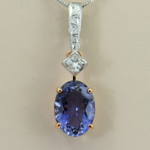 Kendra s Detachable Pendant with Princess Cut Diamond Oval Iolite.JPG