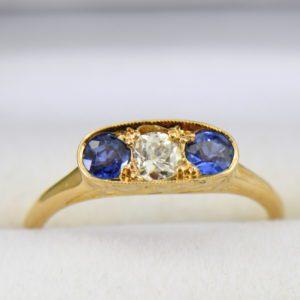 Kendra s Nouveau Sapphire Diamond Yellow Gold 3 stone ring.JPG