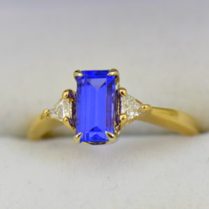 Petite Emerald Cut Tanzanite Trillion Diamond Yellow Gold Ring.JPG