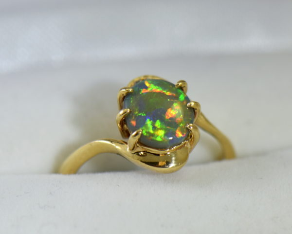 Australian Semi Black Opal set in Yellow Gold Bypass Ring Mounting with Diamond Accents.JPG