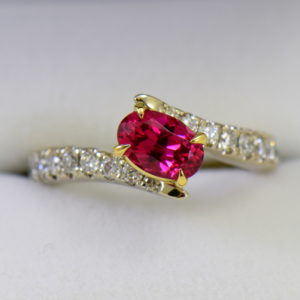 Burmese Neon Redish Pink Spinel set in white gold bypass ring.JPG