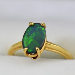 Chinese Writing Pattern Black Opal set in Orange Blossom Yellow Gold Solitaire circa 1930.JPG