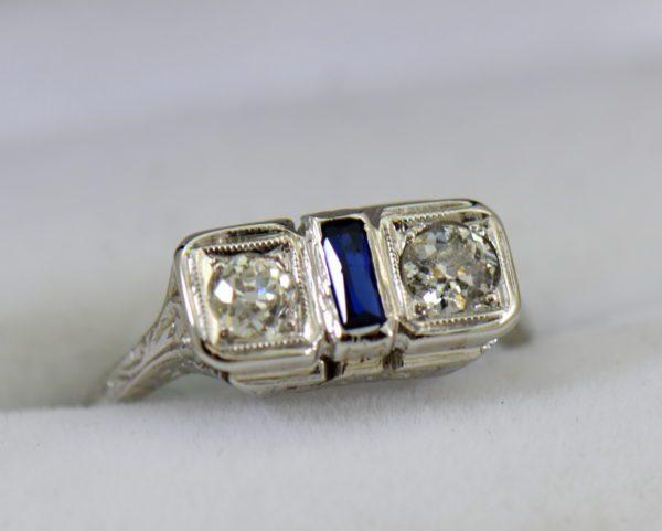 Diamond Synthetic Sapphire Die Struck Art Deco 2 stone ring.JPG