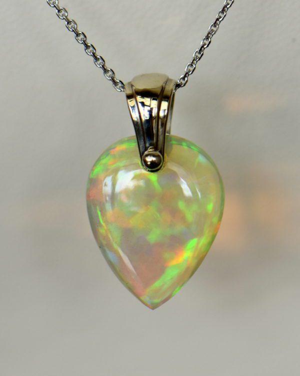 Ethiopian crystal opal bead pendant in white gold.JPG