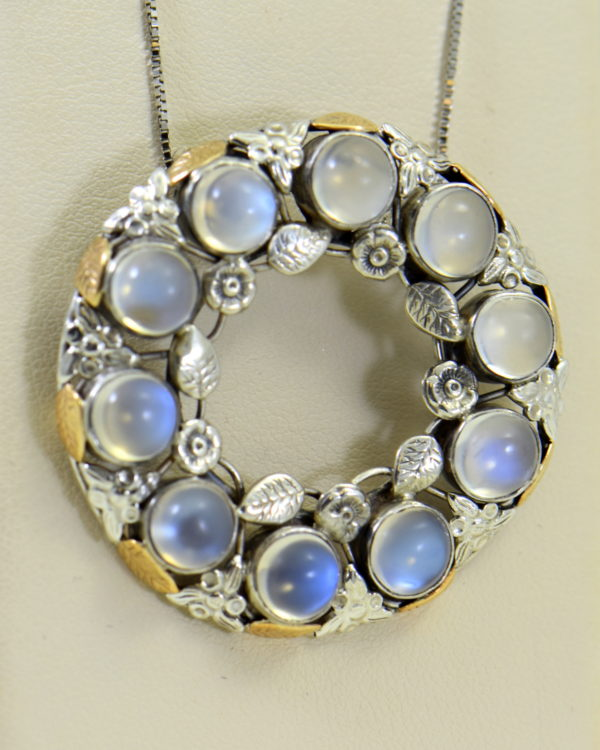 large 1930s floral wreath pendant with blue moonstones in sterling and 14k.JPG