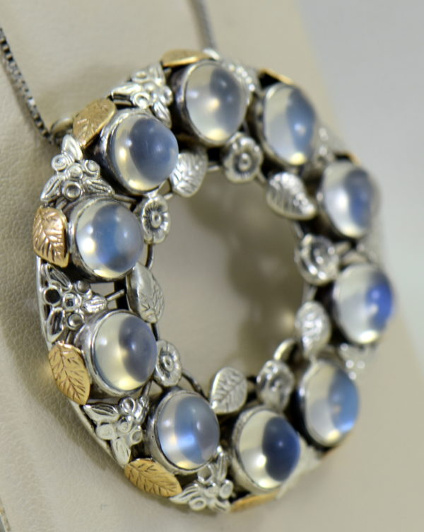 large 1930s floral wreath pendant with blue moonstones in sterling and 14k 2.JPG
