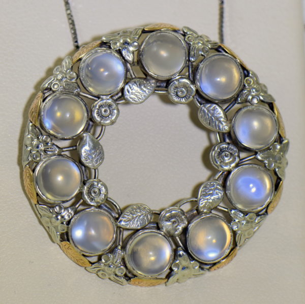 large 1930s floral wreath pendant with blue moonstones in sterling and 14k 3.JPG