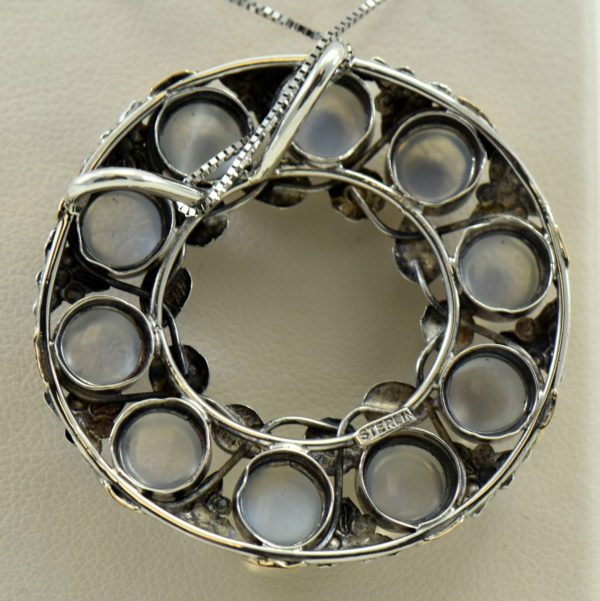 large 1930s floral wreath pendant with blue moonstones in sterling and 14k 5.JPG