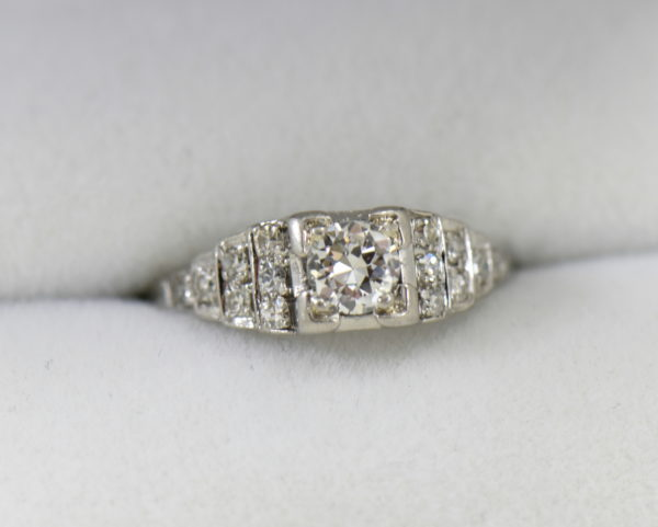 Art Deco .33ct platinum engagement ring with stair step diamond accents.JPG