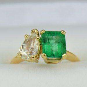 G Modern Two Stone Ring with Pear Diamond Emerald Cut Emerald yellow gold.JPG