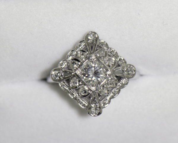 Vintage Diamond Ring .50ct Center Diamond with filigree details in white gold.JPG