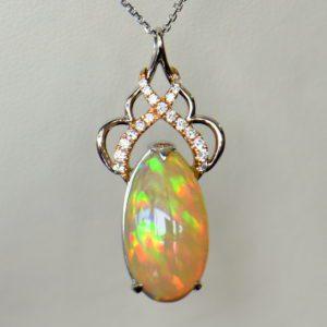 Ethiopian Crystal fire opal pendant with snakeskin pattern prismatic color rose gold 2.JPG