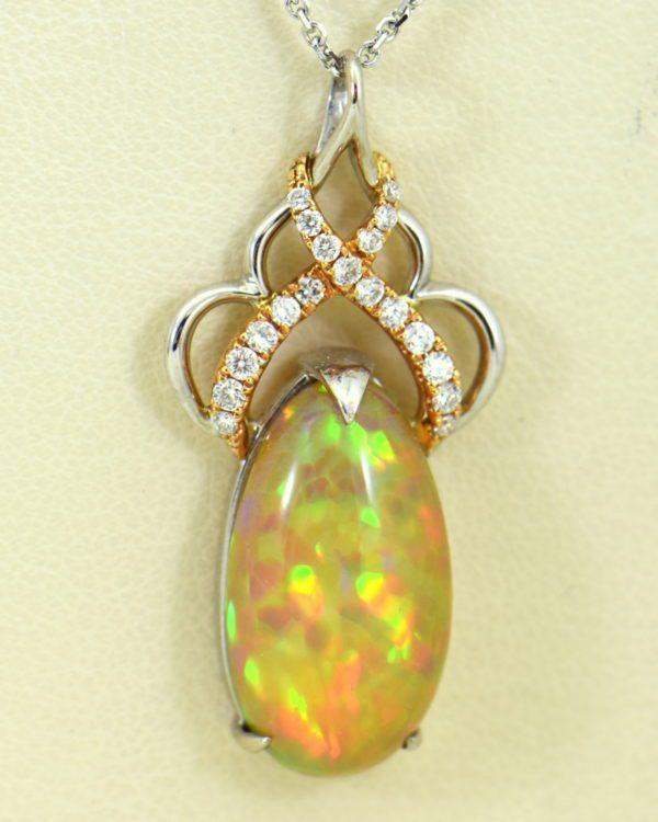 Ethiopian Opal Pendant In Twotone Gold with Snakeskin pattern.JPG