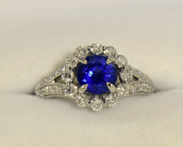 Round blue sapphire diamond halo engagement ring in white gold.JPG
