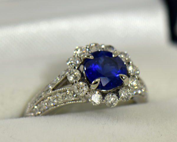 Round blue sapphire diamond halo engagement ring in white gold 2.JPG