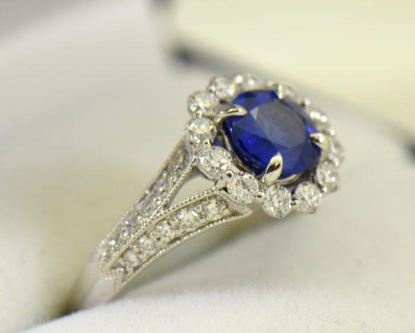 Round blue sapphire diamond halo engagement ring in white gold 3.JPG