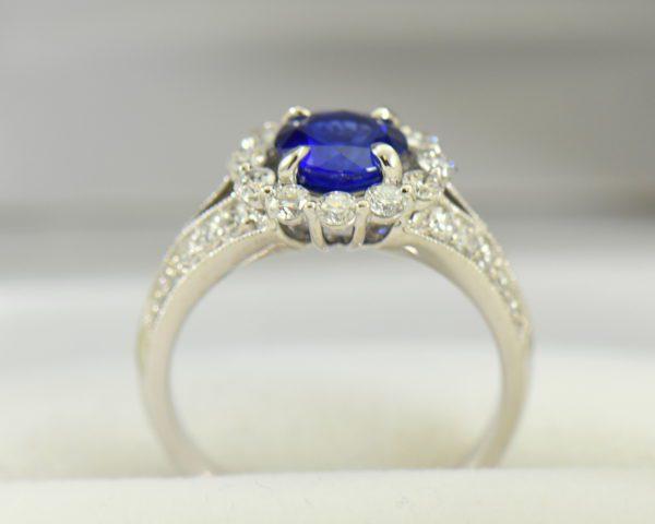 Round blue sapphire diamond halo engagement ring in white gold 4.JPG