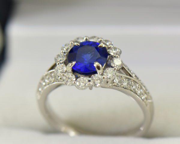 Round blue sapphire diamond halo engagement ring in white gold 6.JPG