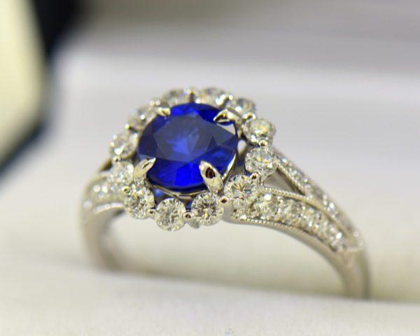 Round blue sapphire diamond halo engagement ring in white gold 8.JPG