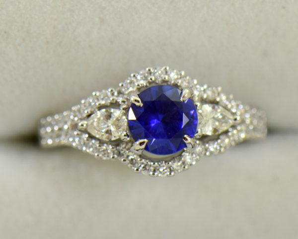 blue violet round sapphire and pear diamond engagement ring.JPG
