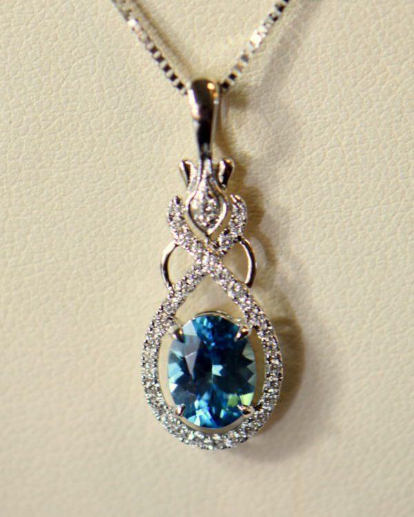 custom december birthstone blue zircon pendant in white gold.JPG