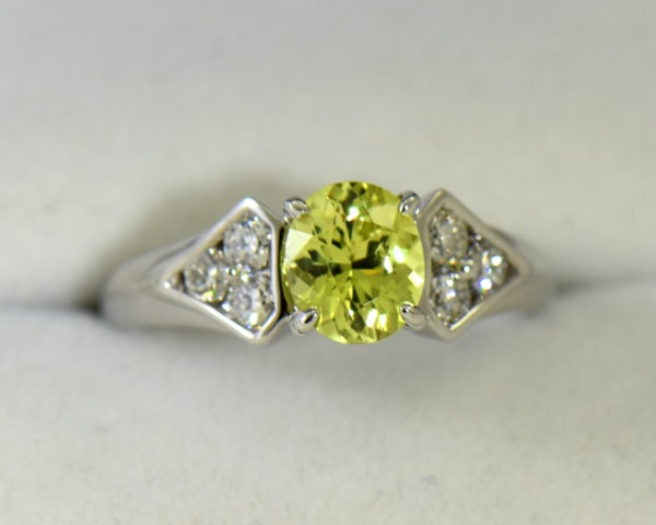 golden yellow chrysoberyl engagement ring with diamond shield accents.JPG