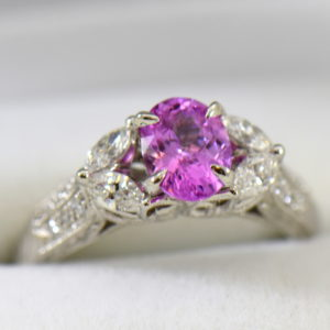 orchid pink sapphire and marquise diamond engangement ring in carved white gold.JPG
