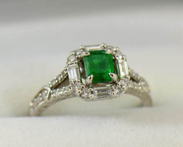 radiant cut natural emerald in baguette diamond halo engagement ring.JPG