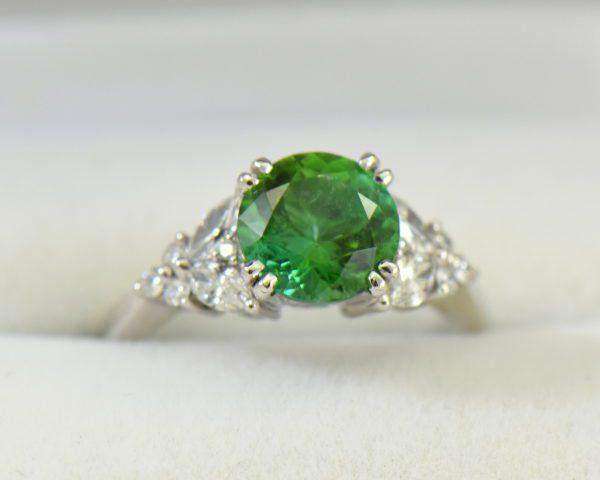 round green tourmaline diamond engagement ring in white gold.JPG