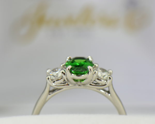 white gold three stone ring with diamonds and oval tsavorite green garnet 3.JPG