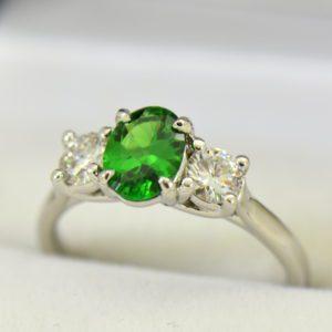 white gold three stone ring with diamonds and oval tsavorite green garnet 4.JPG