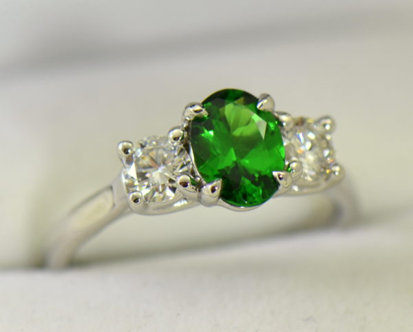 white gold three stone ring with diamonds and oval tsavorite green garnet 5.JPG