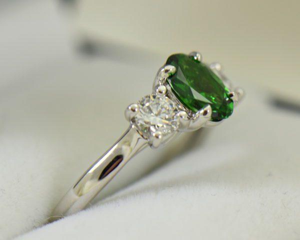 white gold three stone ring with diamonds and oval tsavorite green garnet 6.JPG
